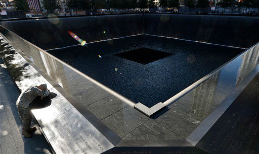 Scott Willens, who joined the United States Army three days after the attacks on Sept. 11, 2001, pauses by the South Pool of the World Trade Center Memorial during the 11th anniversary observance,Tuesday Sept. 11, 2012 in New York. &#40;AP Photo&#47;Justin Lane, Pool, EPA <span class=meta>(AP Photo&#47; Justin Lane)</span>