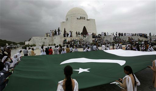 Students hold a huge Pakistani flag at mausoleum of Mohammad Ali Jinnah, the founder of Pakistan to mark Independence Day, in Karachi, Pakistan, Tuesday, Aug. 14, 2012. Pakistan celebrates its 66th Independence Day, to mark its independence from the British rule in 1947. &#40;AP Photo&#47;Shakil Adil&#41; <span class=meta>(AP Photo&#47; Shakil Adil)</span>