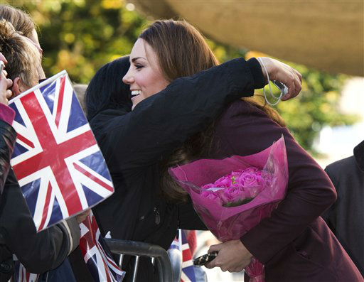 Kate, The Duchess of Cambridge is hugged by a member of the public as she greets well wishers in the street during a visit to Newcastle Civic Center in Newcastle, England Wednesday, Oct. 10, 2012. The Duchess of Cambridge carried out a string of solo engagements in Newcastle Wednesday without the Duke, who is attending the funeral of his former nanny. &#40;AP Photo&#47;Paul Edwards, Pool&#41; <span class=meta>(AP Photo&#47; PAUL EDWARDS)</span>