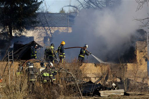 "<div class=""meta ""><span class=""caption-text "">Ministry for Emergency Situations workers and fire fighters work at a site of a fire of a psychiatric hospital Friday morning, April 26, 2013. At least 38 people died in the fire in the psychiatric hospital outside Moscow late Thursday night. Police said the fire, which broke out at about 2 a.m. local time (6 p.m. Eastern, 2200 GMT) in the one-story hospital in the Ramenskoye settlement, was caused by a short circuit. (AP Photo/Pavel Sergeyev) (AP Photo/ Pavel Sergeyev)</span></div>"