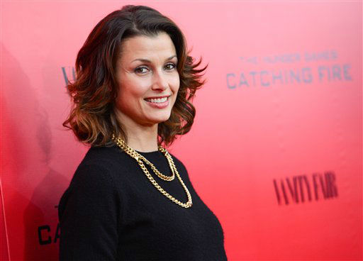 "Actress Bridget Moynahan attends a special screening of ""The Hunger Games: Catching Fire"" at AMC Lincoln Square on Wednesday, Nov. 20, 2013 in New York. (Photo by Evan Agostini/Invision/AP)"