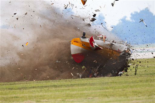 ED&#39;S NOTE GRAPHIC CONTENT: A stunt plane with a wing walker crashes during a performance at the Vectren Air Show, Saturday, June 22, 2013, in Dayton, Ohio. The crash killed the pilot and the wing walker instantly, authorities said. &#40;AP Photo&#47;Thanh V Tran&#41; <span class=meta>(AP Photo&#47; Thanh V Tran)</span>