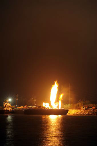 "<div class=""meta ""><span class=""caption-text "">Fire burns aboard two fuel barges along the Mobile River after explosions sent three workers to the hospital Wednesday April 24, 2013. Fire officials have pulled units back from fighting the fire due to the explosions and no immediate threat to lives. (AP Photo John David Mercer) (AP Photo/ John David Mercer)</span></div>"