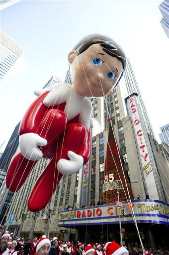 The Elf on the Shelf balloon floats in the Macy&#39;s Thanksgiving Day Parade in New York, Thursday, Nov. 22, 2012. The annual Macy&#39;s Thanksgiving Day Parade put a festive mood in the air in a city still coping with the aftermath of Superstorm Sandy &#40;AP Photo&#47;Charles Sykes&#41; <span class=meta>(AP Photo&#47; Charles Sykes)</span>