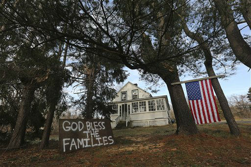 "<div class=""meta image-caption""><div class=""origin-logo origin-image ""><span></span></div><span class=""caption-text"">A sign in support of the victim's families is posted outside a house near Sandy Hook Elementary school,  Saturday, Dec. 15, 2012 in Sandy Hook village of Newtown, Conn. The massacre of 26 children and adults at Sandy Hook Elementary school elicited horror and soul-searching around the world even as it raised more basic questions about why the gunman, 20-year-old Adam Lanza, would have been driven to such a crime and how he chose his victims.  (AP Photo/Mary Altaffer) (AP Photo/ Mary Altaffer)</span></div>"