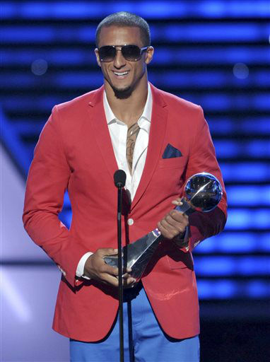 "<div class=""meta ""><span class=""caption-text "">San Francisco 49ers' Colin Kaepernick accepts the award for best breakthrough athlete at the ESPY Awards on Wednesday, July 17, 2013, at Nokia Theater in Los Angeles. (Photo by John Shearer/Invision/AP) (Photo/John Shearer)</span></div>"