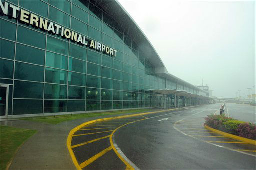 "<div class=""meta image-caption""><div class=""origin-logo origin-image ""><span></span></div><span class=""caption-text"">The main terminal of the Kingston international airport sits empty as Hurricane Sandy approaches Jamaica, Wednesday, Oct. 24, 2012. Hurricane Sandy pounded Jamaica with heavy rain as it headed for landfall near the country's most populous city on a track that would carry it across the Caribbean island to Cuba, and a possible threat to Florida. (AP Photo/Collin Reid) (AP Photo/ Collin Reid)</span></div>"