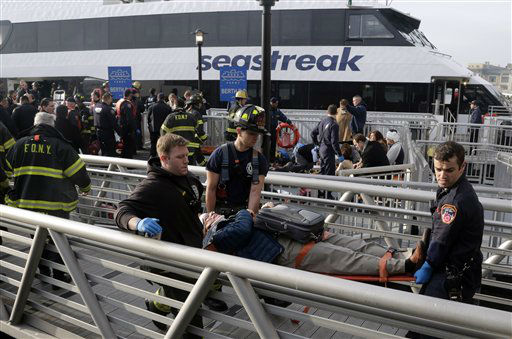 "<div class=""meta image-caption""><div class=""origin-logo origin-image ""><span></span></div><span class=""caption-text"">New York City firefighters remove an injured passenger of the Seastreak Wall Street ferry, in New York,  Wednesday, Jan. 9, 2013. The Seastreak Wall Street ferry from Atlantic Highlands, N.J., banged into the mooring as it arrived at South Street in lower Manhattan during morning rush hour, injuring as many as 50 people, at least one critically, officials said. (AP Photo/Richard Drew) (AP Photo/ Richard Drew)</span></div>"