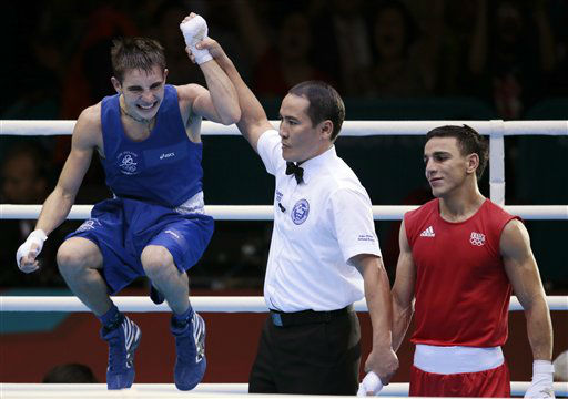 Michael Conlan of Ireland, left, and Nordine Oubaali of France, react after their men&#39;s quarterfinal flyweight 52-kg boxing match at the 2012 Summer Olympics, Tuesday, Aug. 7, 2012, in London. &#40;AP Photo&#47;Ivan Sekretarev&#41; <span class=meta>(AP Photo&#47; Ivan Sekretarev)</span>