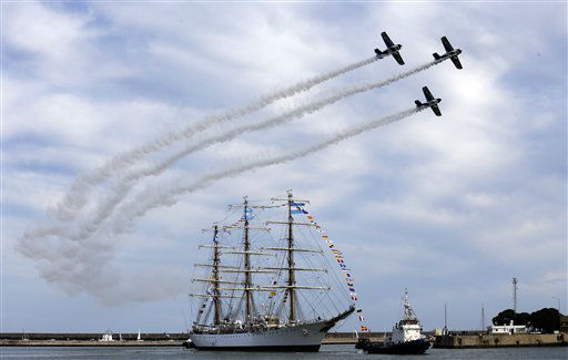Argentina&#39;s naval training tall ship ARA Libertad arrives to port as planes fly overhead during a ceremony in Mar del Plata, Argentina, Wednesday, Jan. 9, 2013. The Argentine naval ship detained for more than two months in Ghana because of a financial dispute returned home to a triumphant welcome. Ghana courts ordered the ship held in October on a claim by Cayman Islands-based hedge fund NML Capital Ltd. But the U.N.&#39;s International Tribunal for the Law of the Sea ordered the ship&#39;s release last month after Argentina argued that warships are immune from seizure. &#40;AP Photo&#47;Natacha Pisarenko&#41; <span class=meta>(AP Photo&#47; Natacha Pisarenko)</span>