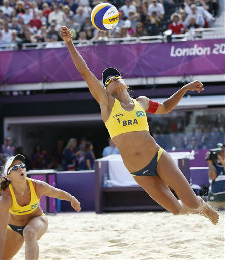 Brazil&#39;s Juliana Silva center, dives for the ball as Juliana Silva looks on during a beach volleyball match against Czech Republic&#39;s Hana Klapalova and Lenka Hajeckova at the 2012 Summer Olympics, London, Wednesday, Aug. 1, 2012. &#40;AP Photo&#47;Jae C. Hong&#41; <span class=meta>(AP Photo&#47; Jae C. Hong)</span>