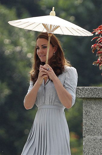 Britain&#39;s Kate, the Duchess of Cambridge pays her respects to war dead of both WWI and WWII at the Kranji Commonwealth War Memorial on Thursday Sept. 13, 2012 in Singapore. &#40;AP Photo&#47;Wong Maye-E&#41; <span class=meta>(AP Photo&#47; Wong Maye-E)</span>