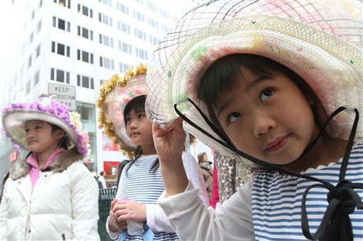 Dressed for the occasion, Elin Chau, 5, right, her sister, Elicia Chau, 7, center, and Jennifer Qiu, 9, all from the Queens borough of New York, pose for photographs on New York&#39;s Fifth Avenue as they take part in the Easter Parade, Sunday, March 31, 2013. &#40;AP Photo&#47;Tina Fineberg&#41; <span class=meta>(AP Photo&#47; Tina Fineberg)</span>