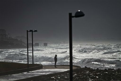 A person looks at waves of the Mediterranean sea in Tel Aviv, Israel, Monday, Jan. 7, 2013. Wind gusts reached up to 40mph, as waves reached 9 meters high &#40;30 feet&#41;. &#40;AP Photo&#47;Ariel Schalit&#41; <span class=meta>(AP Photo&#47; Ariel Schalit)</span>