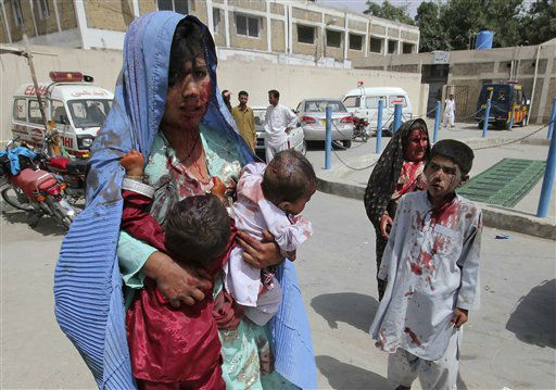 An injured mother carries her wounded children to a local hospital in Quetta, Pakistan on Tuesday, Aug. 21, 2012. Police say a roadside bomb targeting a security convoy has killed at least one civilian and wounded several others in southwestern Pakistan. &#40;AP Photo&#47;Arshad Butt&#41; <span class=meta>(AP Photo&#47; Arshad Butt)</span>