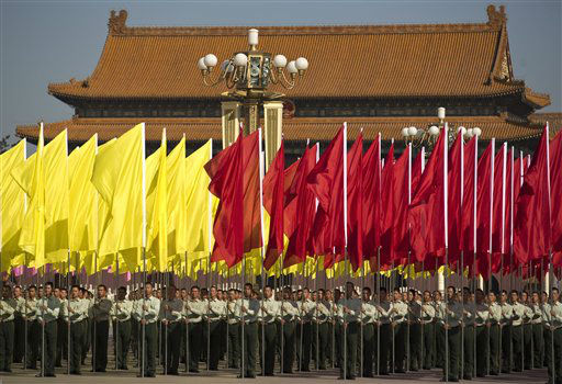 Chinese soldiers holding red and yellow flags stand at Tiananmen Square during a ceremony marking National Day in Beijing Monday, Oct. 1, 2012.  &#40;AP Photo&#47;Andy Wong&#41; <span class=meta>(AP Photo&#47; Andy Wong)</span>