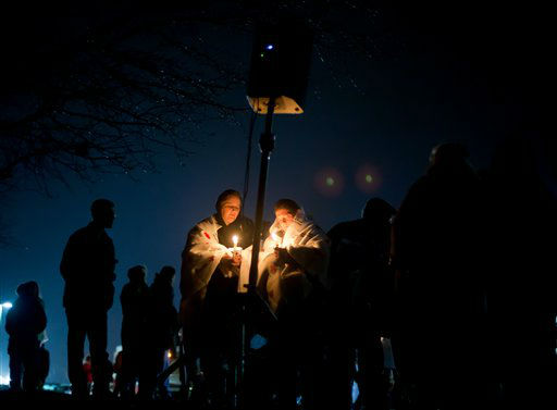 Mourners listen to a memorial service over a loudspeaker outside Newtown High School for the victims of the Sandy Hook Elementary School shooting, Sunday, Dec. 16, 2012, in Newtown, Conn. A gunman walked into the elementary school Friday and opened fire, killing 26 people, including 20 children. &#40;AP Photo&#47;David Goldman&#41; <span class=meta>(AP Photo&#47; David Goldman)</span>