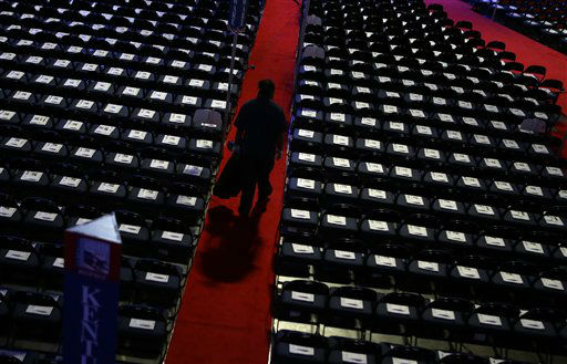 A worker walks down the isle to collect trash on the floor at the Republican National Convention in Tampa, Fla., on Wednesday, Aug. 29, 2012. &#40;AP Photo&#47;David Goldman&#41; <span class=meta>(AP Photo&#47; David Goldman)</span>