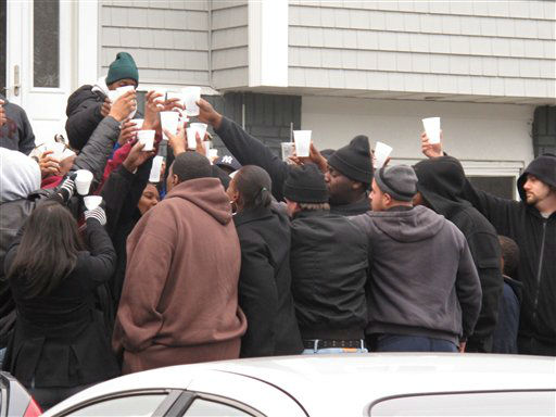 Friends and relatives of Kansas City Chiefs linebacker Jovan Belcher drink a toast outside the player&#39;s home on Saturday, Dec. 1, 2012, in West Babylon, N.Y. The Long Island native shot and killed his girlfriend then killed himself on Saturday in Kansas City.&#40;AP Photo&#47;Frank Eltman&#41; <span class=meta>(AP Photo&#47; Frank Eltman)</span>