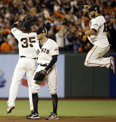 San Francisco Giants&#39; Angel Pagan leaps up to celebrate with Brandon Crawford and Hunter Penc after the Giants beat the Detroit Tigers 2-0 in Game 2 of baseball&#39;s World Series Thursday, Oct. 25, 2012, in San Francisco. &#40;AP Photo&#47;David J. Phillip&#41; <span class=meta>(AP Photo&#47; David J. Phillip)</span>