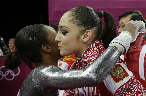 U.S. gymnast Gabrielle Douglas, left, congratulates Russia&#39;s Aliya Mustafina for winning the gold for the uneven bars during the artistic gymnastics women&#39;s apparatus finals at the 2012 Summer Olympics, Monday, Aug. 6, 2012, in London. &#40;AP Photo&#47;Julie Jacobson&#41; <span class=meta>(AP Photo&#47; Julie Jacobson)</span>