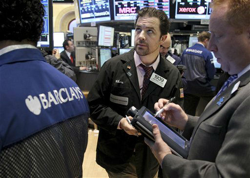 "<div class=""meta image-caption""><div class=""origin-logo origin-image ""><span></span></div><span class=""caption-text"">Traders work on the floor at the New York Stock Exchange in New York, Wednesday, Oct. 31, 2012. Traffic is snarled, subways out of commission, streets flooded and power out in many parts of the city, but the New York Stock Exchange opened without hitch Wednesday after an historic two-day shutdown, courtesy of superstorm Sandy. (AP Photo/Seth Wenig) (AP Photo/ Seth Wenig)</span></div>"