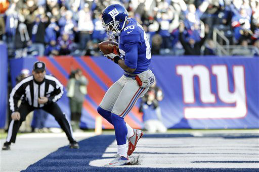 "<div class=""meta ""><span class=""caption-text "">New York Giants wide receiver Victor Cruz (80) catches a pass for a touchdown during the first half of an NFL football game against the Philadelphia Eagles, Sunday, Dec. 30, 2012, in East Rutherford, N.J. (AP Photo/Kathy Willens) (AP Photo/ Kathy Willens)</span></div>"