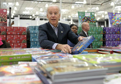 Vice President Joe Biden looks over a selection of books while shopping at a Costco in Washington, Thursday, Nov. 29, 2012. Biden went shopping for presents and to highlight the importance of renewing middle-class tax cuts so families and businesses have more certainty at this critical time for our economy. &#40;AP Photo&#47;Susan Walsh&#41; <span class=meta>(AP Photo&#47; Susan Walsh)</span>