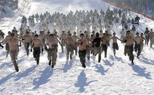 Shirtless South Korean Marines and their U.S. counterparts from 3-Marine Expeditionary Force 1st Battalion from Kaneho Bay, Hawaii, run on a snow covered field during their Feb. 4-22 joint military winter exercise in Pyeongchang, east of Seoul, South Korea, Thursday, Feb. 7, 2013. More than 400 marines from the two countries participated in the joint winter exercise held for the first time in South Koreas. &#40;AP Photo&#47;Lee Jin-man&#41; <span class=meta>(AP Photo&#47; Lee Jin-man)</span>