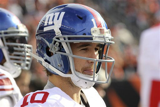 New York Giants quarterback Eli Manning stands on the sidelines in the second half of an NFL football game against the Cincinnati Bengals, Sunday, Nov. 11, 2012, in Cincinnati. &#40;AP Photo&#47;Tom Uhlman&#41; <span class=meta>(AP Photo&#47; Tom Uhlman)</span>