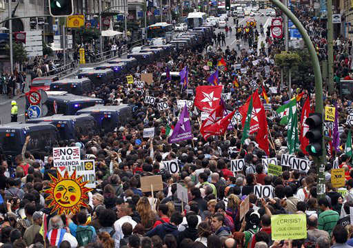 "<div class=""meta image-caption""><div class=""origin-logo origin-image ""><span></span></div><span class=""caption-text"">Protestors march to the parliament against austerity measures announced by the Spanish government, in Madrid, Spain, Tuesday, Sept. 25, 2012. Spain's Parliament has taken on the appearance of a heavily guarded fortress with dozens of police blocking access from every possible angle, hours ahead of a protest against the conservative government's handling of the economic crisis. The demonstration, organized behind the slogan 'Occupy Congress,' is expected to draw thousands of people. It is due to start around 1730 GMT Tuesday. Madrid authorities said some 1,300 police would be deployed. The protestors call for Parliament to be dissolved and fresh elections held, claiming the government's austerity measures show the ruling Popular Party misled voters to get elected last November. (AP Photo/Andres Kudacki) (AP Photo/ Andres Kudacki)</span></div>"