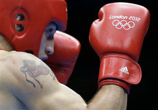 Azerbaijan&#39;s Teymur Mammadov &#40;in red&#41; fights Australia&#39;s Jai Tapu Opetaia during a heavyweight 91-kg preliminary boxing match at the 2012 Summer Olympics, Wednesday, Aug. 1, 2012, in London. &#40;AP Photo&#47;Patrick Semansky&#41; <span class=meta>(AP Photo&#47; Patrick Semansky)</span>