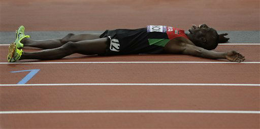 Kenya&#39;s Ezekiel Kemboi celebrates winning gold in the men&#39;s 3000-meter steeplechase during the athletics in the Olympic Stadium at the 2012 Summer Olympics, London, Sunday, Aug. 5, 2012. &#40;AP Photo&#47;David J. Phillip &#41; <span class=meta>(AP Photo&#47; David J. Phillip)</span>