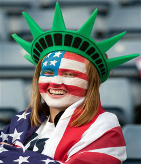 A supporter of the United States smiles with her face painted like an American flag while watching the group G women&#39;s soccer match between the United States and Colombia at the London 2012 Summer Olympics, Saturday, July 28, 2012, at Hampden Park Stadium in Glasgow, Scotland. &#40;AP Photo&#47;Chris Clark&#41; <span class=meta>(AP Photo&#47; Chris Clark)</span>