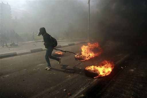 "<div class=""meta ""><span class=""caption-text "">A man burns tires during a protest to support Palestinian prisoners, outside Ofer, an Israeli military prison, near the West Bank city of Ramallah, Monday, Feb. 25, 2013. The fate of the prisoners is sensitive in Palestinian society, where virtually every family has had a member imprisoned by Israel. Detainees are held on a range of charges, from stone-throwing to deadly attacks, and are seen as heroes resisting occupation. Israelis tend to view them as terrorists. (AP Photo/Majdi Mohammed)</span></div>"