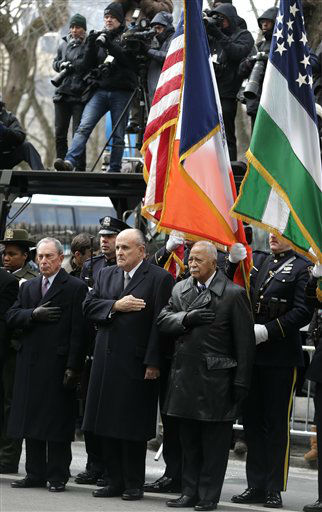 New York City Mayor Michael Bloomberg, left, and former New York City Mayors Rudolph Giuliani, center, and David Dinkins put their hands over their hearts as a casket containing the body of former New York City Mayor Ed Koch leaves a synagogue after his funeral in New York, Monday, Feb. 4, 2013. Koch was remembered as the quintessential New Yorker during a funeral that frequently elicited laughter, recalling his famous one-liners and amusing antics in the public eye. Koch died Friday of congestive heart failure at age 88. &#40;AP Photo&#47;Seth Wenig&#41; <span class=meta>(AP Photo&#47; Seth Wenig)</span>