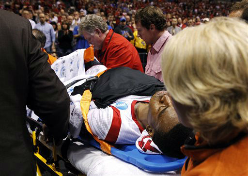 "<div class=""meta ""><span class=""caption-text "">Louisville guard Kevin Ware is taken off the court on a stretcher after badly injuring his lower right leg during the first half of the Midwest Regional final against Duke in the NCAA college basketball tournament, Sunday, March 31, 2013, in Indianapolis. (AP Photo/Darron Cummings) (AP Photo/ Darron Cummings)</span></div>"