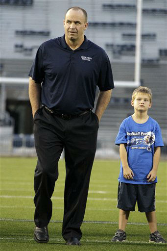 Penn State head coach Bill O&#39; Brien, left center, stands with his son Michael, right center, with his team on the field at Beaver Stadium during a Football Eve rally in State College, Pa., Friday, Aug. 31, 2012. Penn State opens its season at home Saturday against Ohio University. &#40;AP Photo&#47;Gene J. Puskar&#41; <span class=meta>(AP Photo&#47; Gene J. Puskar)</span>