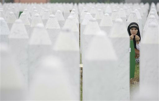 "<div class=""meta image-caption""><div class=""origin-logo origin-image ""><span></span></div><span class=""caption-text"">Bosnian woman Merima Nukic prays at the grave of her father during a funeral ceremony at the memorial center in Potocari, near Srebrenica, 160 kms east of Sarajevo, Bosnia, Thursday, July 11, 2013. People from around Bosnia and abroad have begun arriving in Srebrenica Thursday to commemorate 18th anniversary of the 1995 massacre and rebury recently identified victims exhumed from mass graves. The victims? bodies are still being exhumed from mass graves in the area, where Serbs had dumped them in an attempt to cover up the crime. Identified victims are buried each year on the massacre?s anniversary at a memorial cemetery near Srebrenica. (AP Photo/Amel Emric) (AP Photo/ Amel Emric)</span></div>"