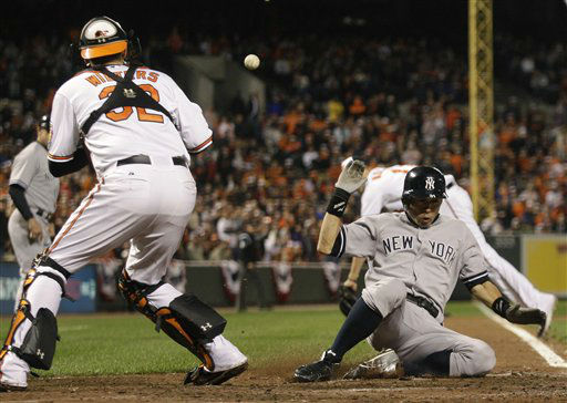 New York Yankees&#39; Ichiro Suzuki, of Japan, slides past Baltimore Orioles catcher Matt Wieters for a run on a double by Robinson Cano in the ninth inning of Game 1 of the American League division baseball series on Sunday, Oct. 7, 2012, in Baltimore. New York won 7-2. &#40;AP Photo&#47;Nick Wass&#41; <span class=meta>(AP Photo&#47; Nick Wass)</span>