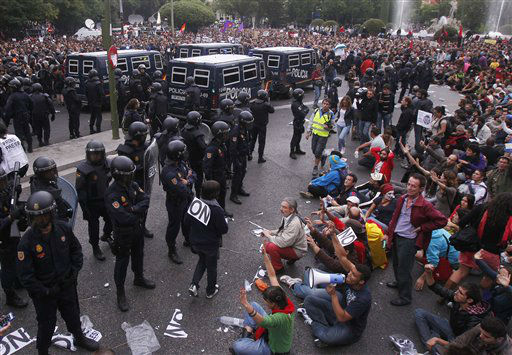 "<div class=""meta ""><span class=""caption-text "">Police  stand guard as protestors shout slogans during a demonstration at the parliament against austerity measures announced by the Spanish government, in Madrid, Spain, Tuesday, Sept. 25, 2012. Spain's Parliament has taken on the appearance of a heavily guarded fortress with dozens of police blocking access from every possible angle. The demonstration, organized behind the slogan 'Occupy Congress,' was expected to draw thousands of people.  Madrid authorities said some 1,300 police would be deployed. The protestors call for Parliament to be dissolved and fresh elections held, claiming the government's austerity measures show the ruling Popular Party misled voters to get elected last November. (AP Photo/Andres Kudacki) (AP Photo/ Andres Kudacki)</span></div>"