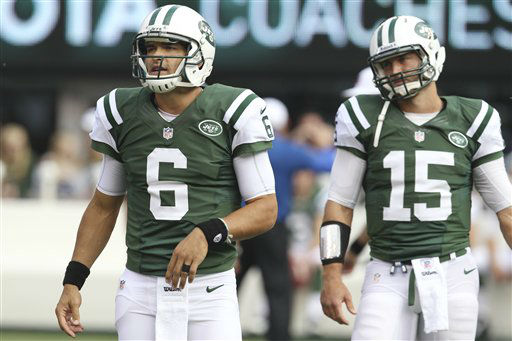 New York Jets quarterback Mark Sanchez and Tim Tebow warm up before an NFL football game against the Indianapolis Colts Sunday, Oct. 14, 2012 in East Rutherford, N.J. &#40;AP Photo&#47;Seth Wenig&#41; <span class=meta>(AP Photo&#47; Seth Wenig)</span>