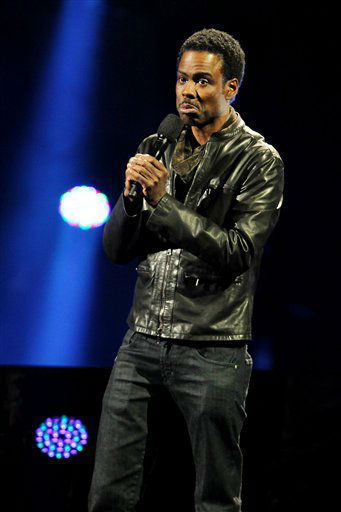 "<div class=""meta ""><span class=""caption-text "">This image released by Starpix shows Chris Rock at the 12-12-12 The Concert for Sandy Relief at Madison Square Garden in New York on Wednesday, Dec. 12, 2012. Proceeds from the show will be distributed through the Robin Hood Foundation. (AP Photo/Starpix, Dave Allocca) (AP Photo/ Dave Allocca)</span></div>"