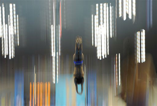 A competitor dives during a practice session at the Aquatics Centre in the Olympic Park ahead of the 2012 Summer Olympics in London, Friday, July 27, 2012. &#40;AP Photo&#47;Mark J. Terrill&#41; <span class=meta>(AP Photo&#47; Mark J. Terrill)</span>