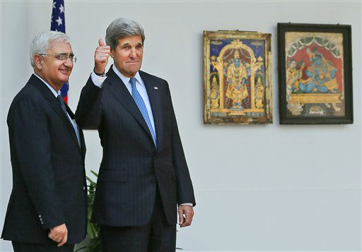 "<div class=""meta image-caption""><div class=""origin-logo origin-image ""><span></span></div><span class=""caption-text"">Indian Foreign Minister Salman Khurshid, left, smiles as U.S. Secretary of State John Kerry gives a thumbs up to media before their meeting in New Delhi, India, Monday, June 24, 2013. (AP Photo /Manish Swarup) (AP Photo/ Manish Swarup)</span></div>"