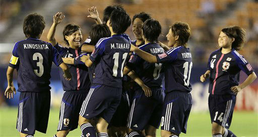 Japan&#39;s defender Yushika Nakamura, second left, celebrates with teammates after scoring her team&#39;s third goal against Switzerland during their Group A match of the U20 women&#39;s World Cup soccer tournament  in Tokyo, Sunday, Aug. 26, 2012. Japan beat Switzerland 4-0. &#40;AP Photo&#47;Shizuo Kambayashi&#41; <span class=meta>(AP Photo&#47; Shizuo Kambayashi)</span>