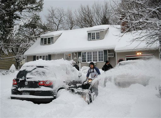 Eguin Belasquez steers a snow blower through mounds of snow as he helps his friend dig out of his driveway after a snow storm on Saturday, Feb. 9, 2013 in Sea Cliff, N.Y. &#40;AP Photo&#47;Kathy Kmonicek&#41; <span class=meta>(AP Photo&#47; Kathy Kmonicek)</span>