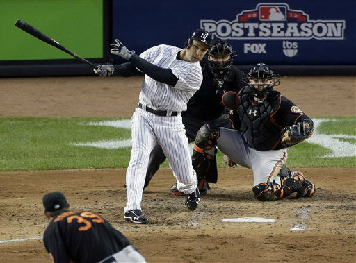 New York Yankees&#39; Raul Ibanez hits an RBI single against Baltimore Orioles pitcher Jason Hammel during the fifth inning in Game 5 of the American League division baseball series on Friday, Oct. 12, 2012, in New York. The Yankees&#39; Mark Teixeira scored from second on the hit. Orioles&#39; catcher Matt Wieters and home plate umpire Mike Everitt watch the hit. Jason Hammel was pitching. &#40;AP Photo&#47;Peter Morgan&#41; <span class=meta>(AP Photo&#47; Peter Morgan)</span>