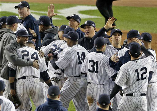 The New York Yankees celebrate after winning the American League division baseball series after beating the Baltimore Orioles 3-1 in Game 5 on Friday, Oct. 12, 2012, in New York. &#40;AP Photo&#47;Peter Morgan&#41; <span class=meta>(AP Photo&#47; Peter Morgan)</span>