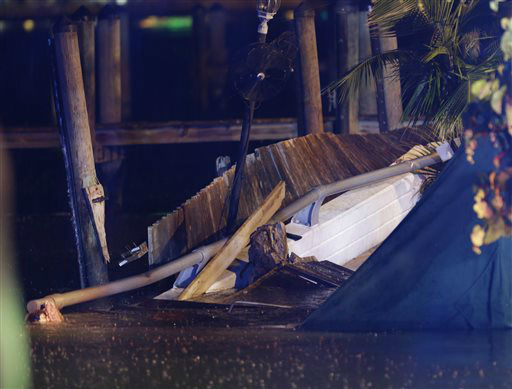 A partial view of the collapsed outdoor deck at Shuckers Bar and Restaurant, a popular Miami-area sports bar, the deck was packed with people, Thursday June 13, 2013. The packed outdoor deck behind the popular Miami-area sports bar partially collapsed during the NBA Finals on Thursday night, sending dozens of patrons into the shallow waters of Biscayne Bay. &#40;AP Photo&#47;Alan Diaz&#41; <span class=meta>(AP Photo&#47; Alan Diaz)</span>